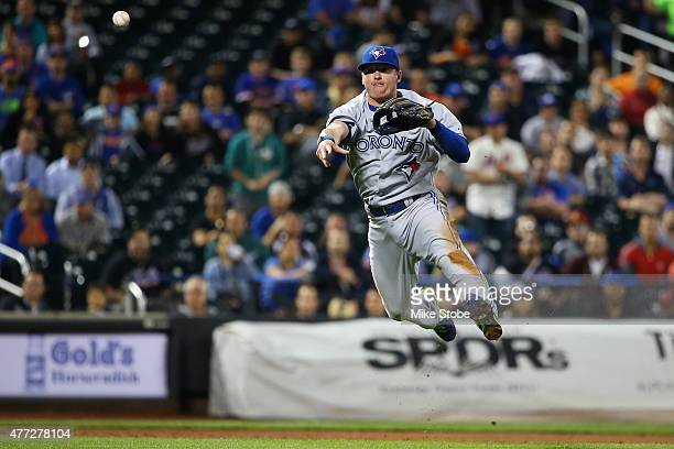 Josh Donaldson of the Toronto Blue Jays throws out Michael Cuddyer of the New York Mets on a groundball in the sixth inning at Citi Field on June 15...