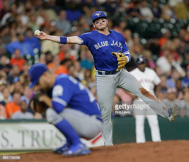 Josh Donaldson of the Toronto Blue Jays throws over pitcher Marco Estrada to retire George Springer of the Houston Astros in the sixth inning at...