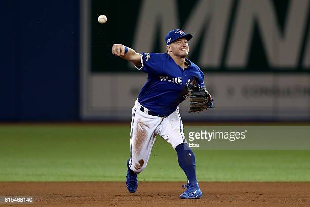 Josh Donaldson of the Toronto Blue Jays throws to first basel hit by Carlos Santana of the Cleveland Indians for the final out of the fifth inning...