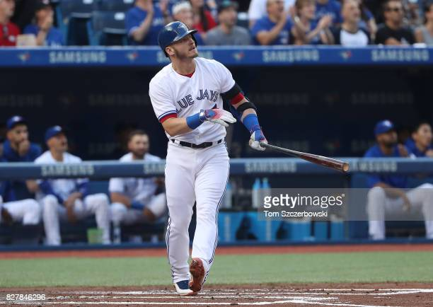 Josh Donaldson of the Toronto Blue Jays watches as he hits a tworun home run in the first inning during MLB game action against the New York Yankees...