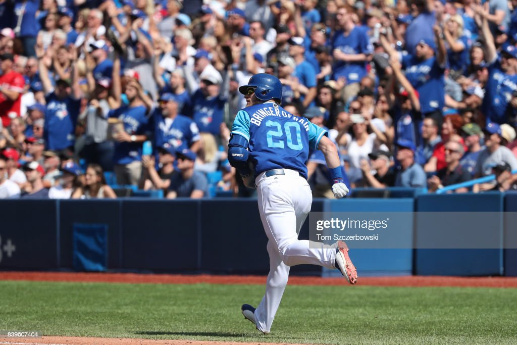 Josh Donaldson #20 of the Toronto Blue Jays watches the baseball as he hits a two-run home run in the fifth inning during MLB game action against the Minnesota Twins at Rogers Centre on August 26, 2017 in Toronto, Canada.