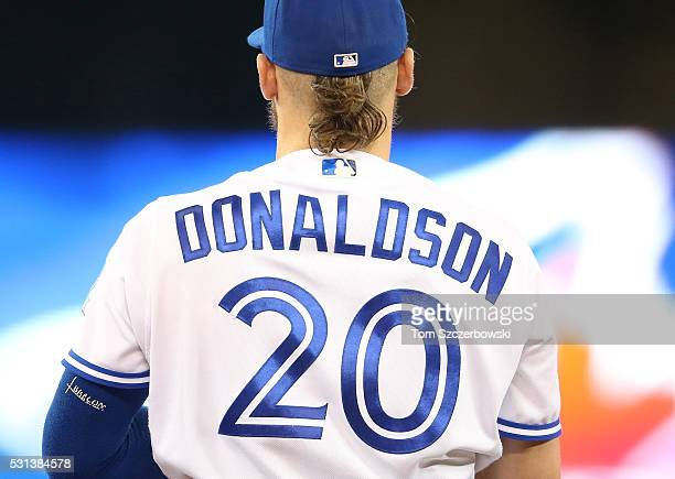 Josh Donaldson of the Toronto Blue Jays wears his hair in a bun during MLB game action against the Texas Rangers on May 5 2016 at Rogers Centre in...