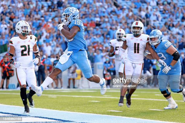 Josh Downs of the North Carolina Tar Heels scores a touchdown during the first half of their game against the Miami Hurricanes at Kenan Memorial...