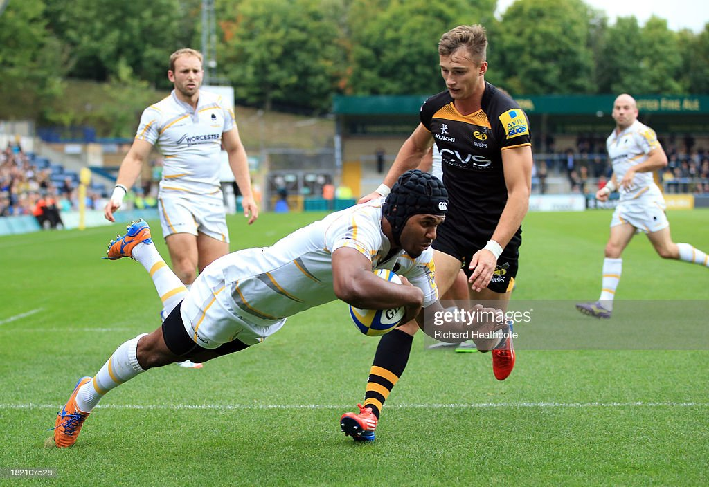 Josh Drauniniu of Worcester dives over to score a try during the Aviva Premiership match between London Wasps and Worcester Warriors at Adams Park on September 28, 2013 in High Wycombe, England.