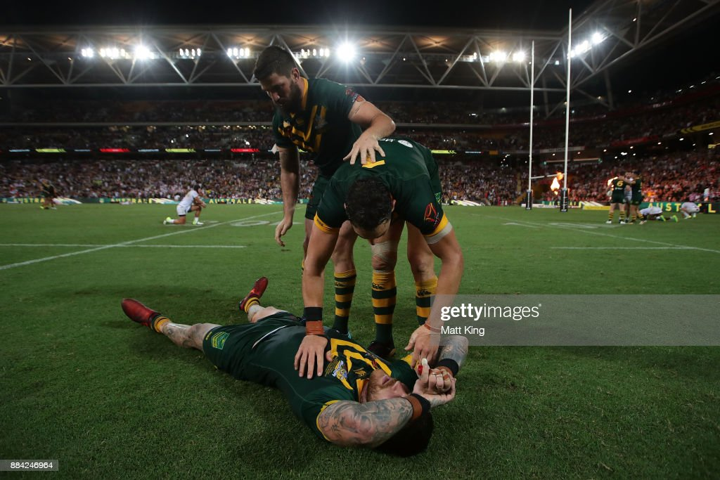 Josh Dugan, Billy Slater and Matt Gillett of the Kangaroos celebrate winning the 2017 Rugby League World Cup Final between the Australian Kangaroos and England at Suncorp Stadium on December 2, 2017 in Brisbane, Australia.