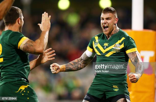Josh Dugan of Australia celebrates scoring a try during the ANZAC Test match between the Australian Kangaroos and the New Zealand Kiwis at GIO...