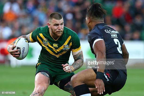 Josh Dugan of Australia looks to avoid being tackled by Solomone Kata of New Zealand during the International Rugby League Test match between the...