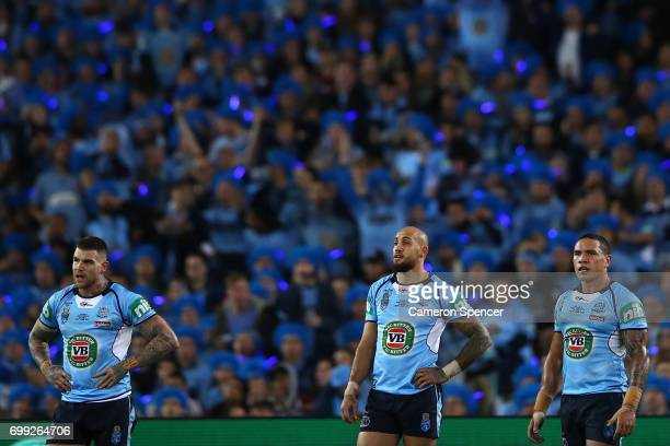 Josh Dugan of the Blues Blake Ferguson of the Blues and Tyson Frizell of the Blues look on during game two of the State Of Origin series between the...
