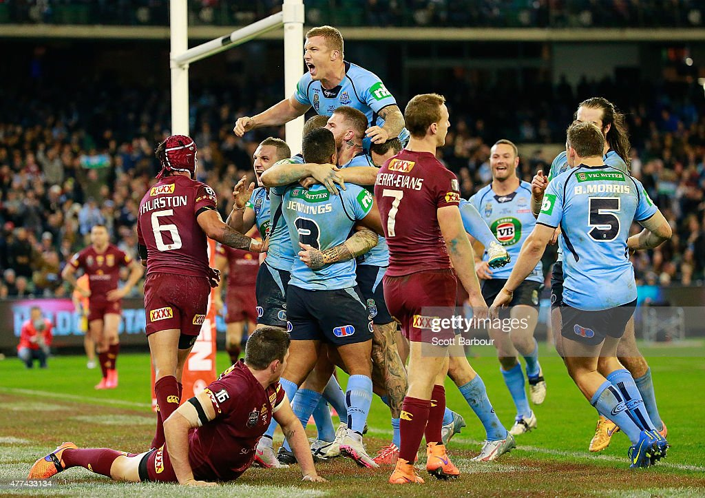 Josh Dugan of the Blues celebrates with his teammates after scoring a try during game two of the State of Origin series between the New South Wales Blues and the Queensland Maroons at the Melbourne Cricket Ground on June 17, 2015 in Melbourne, Australia.