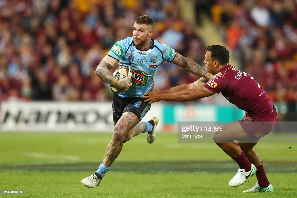 Josh Dugan of the Blues is tackled by William Chambers of the Maroons during game one of the State Of Origin series between the Queensland Maroons and the New South Wales Blues at Suncorp Stadium on May 31, 2017 in Brisbane, Australia.