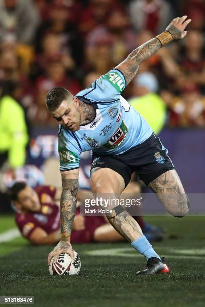 Josh Dugan of the Blues scores a try during game three of the State Of Origin series between the Queensland Maroons and the New South Wales Blues at...