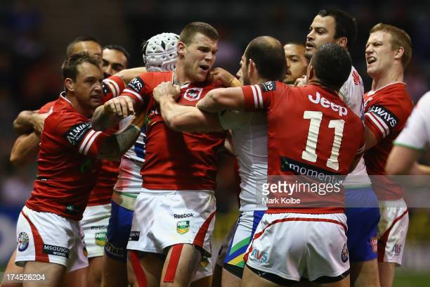 Josh Dugan of the Dragons and his team mates scuffle with Raiders players during the round 20 match between the St George Illawarra Dragons and the...