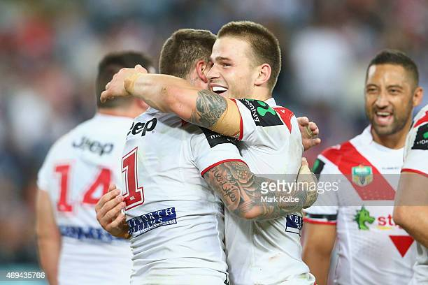 Josh Dugan of the Dragons congratulates Euan Aitken of the Dragons as he celebrates after scoring a try during the round six NRL match between the St...