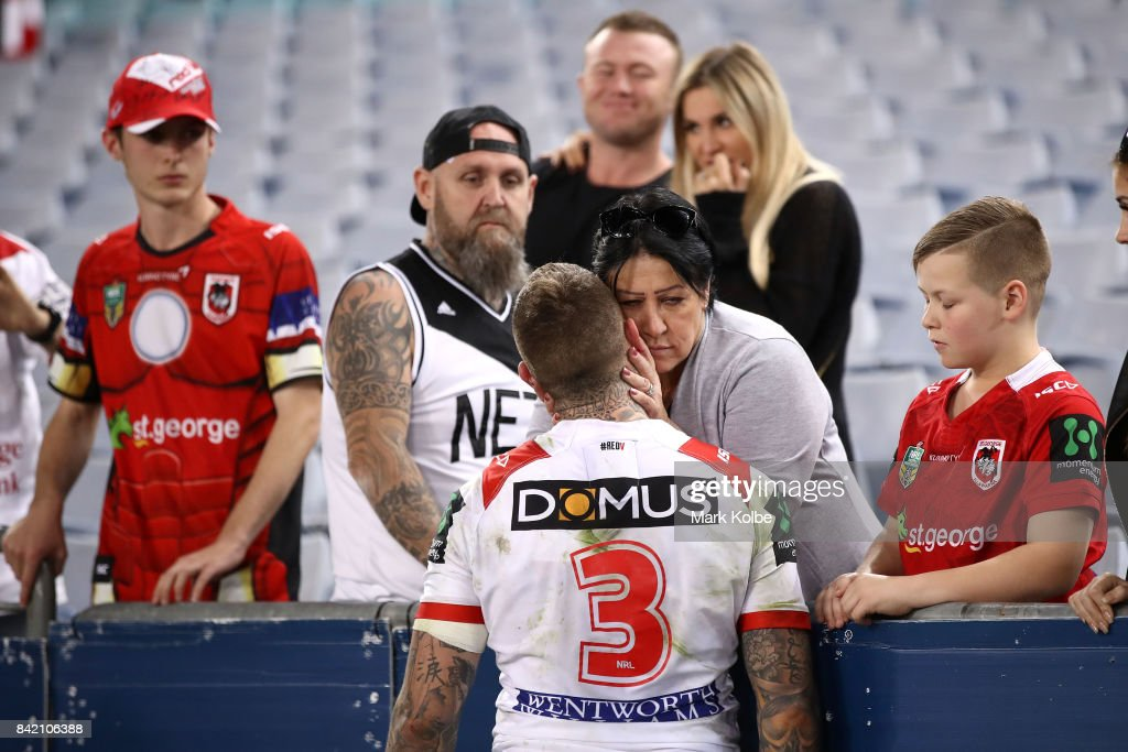 Josh Dugan of the Dragons is consoled after defeat during the round 26 NRL match between the St George Illawarra Dragons and the Canterbury Bulldogs at ANZ Stadium on September 3, 2017 in Sydney, Australia.
