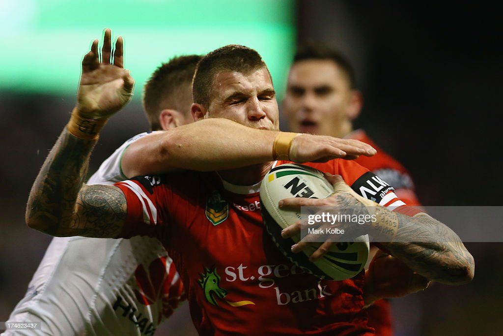 Josh Dugan of the Dragons is hit in a high tackle during the round 20 match between the St George Illawarra Dragons and the Canberra Raiders at WIN Stadium on July 27, 2013 in Wollongong, Australia.