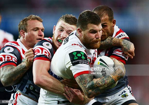 Josh Dugan of the Dragons is tackled ball during the round eight NRL match between the St George Illawarra Dragons and the Sydney Roosters at Allianz...