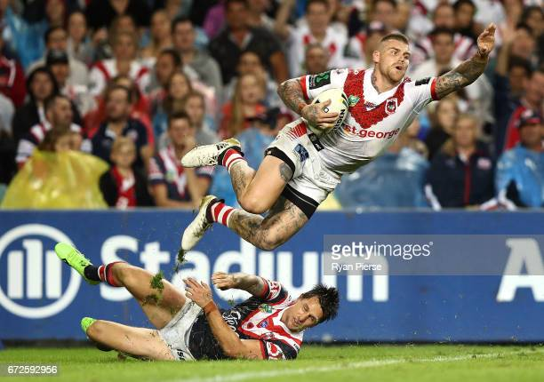Josh Dugan of the Dragons is tackled by Mitchell Pearce of the Roosters in the ingoal area during the round eight NRL match between the Sydney...