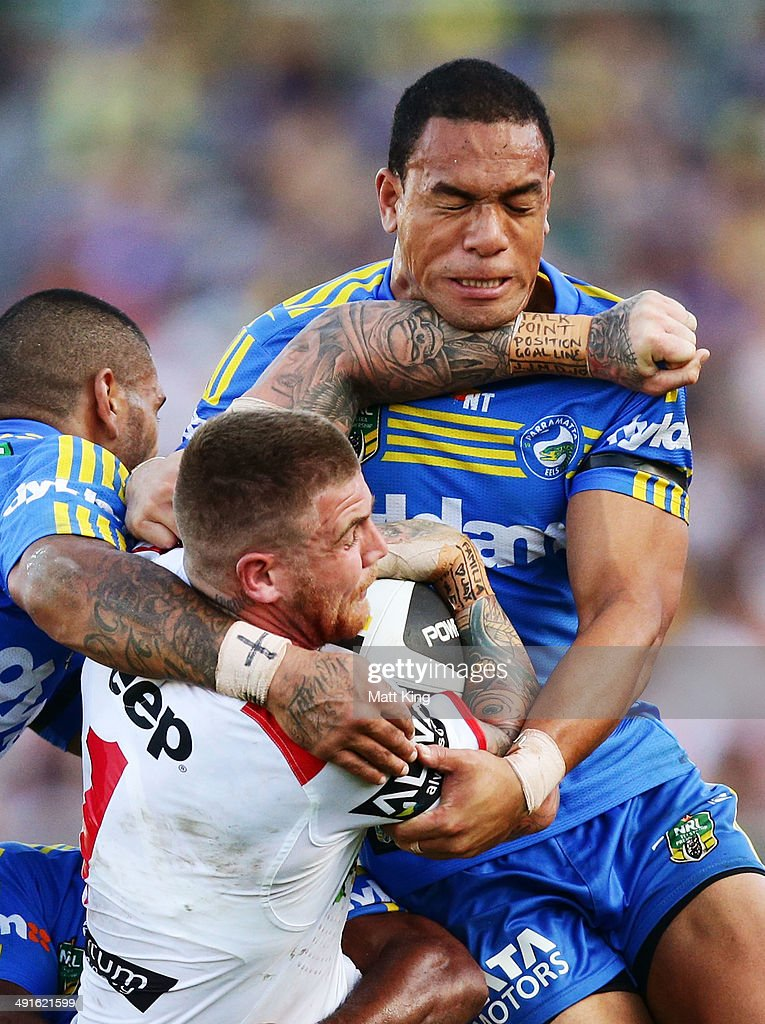 Josh Dugan of the Dragons is tackled by Will Hopoate of the Eels during the round 10 NRL match between the Parramatta Eels and the St George Illawarra Dragons at Pirtek Stadium on May 17, 2014 in Sydney, Australia.