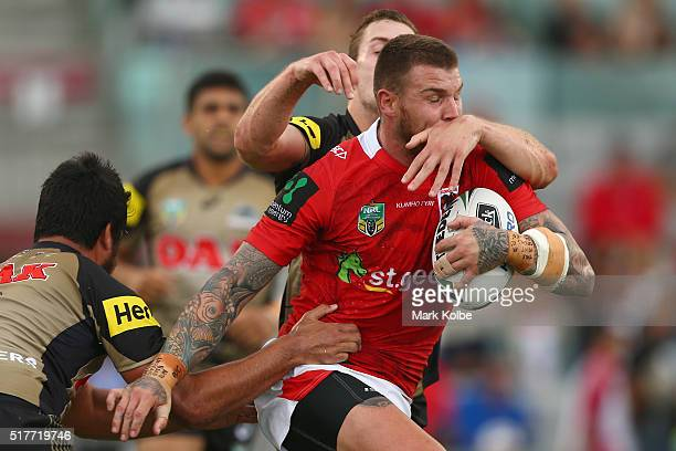 Josh Dugan of the Dragons is tackled during the round four NRL match between the St George Illawarra Dragons and the Penrith Panthers at WIN Stadium...