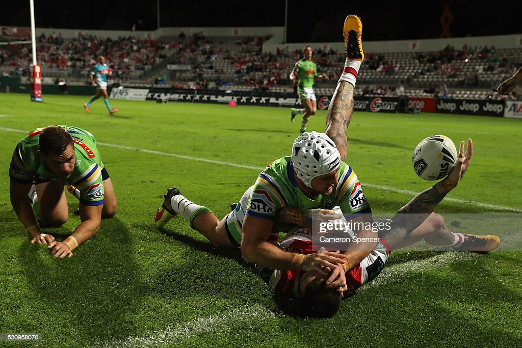Josh Dugan of the Dragons is tackled over the sideline by Jarrod Croker of the Raiders during the round 10 NRL match between the St George Illawarra Dragons and the Canberra Raiders on May 12, 2016 in Sydney, Australia.