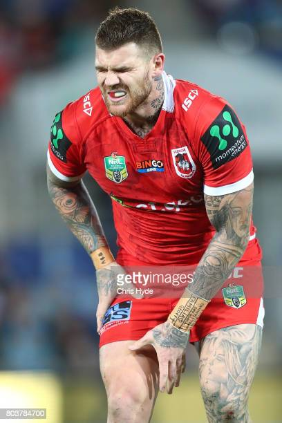 Josh Dugan of the Dragons leaves the field injured during the round 17 NRL match between the Gold Coast Titans and the St George Illawarra Dragons at...