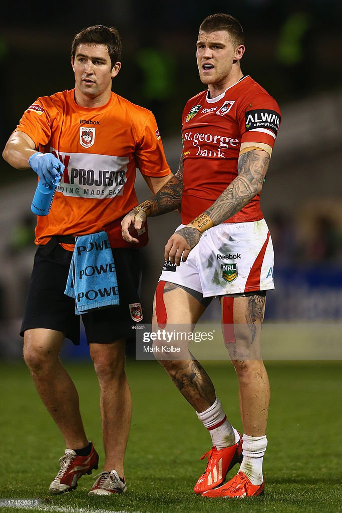 Josh Dugan of the Dragons leaves the field with the trainer after a head knock during the round 20 match between the St George Illawarra Dragons and the Canberra Raiders at WIN Stadium on July 27, 2013 in Wollongong, Australia.