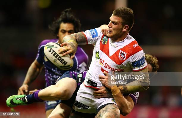 Josh Dugan of the Dragons looks to offload during the round 16 NRL match between the St George Illawarra Dragons and the Melbourne Storm at WIN...