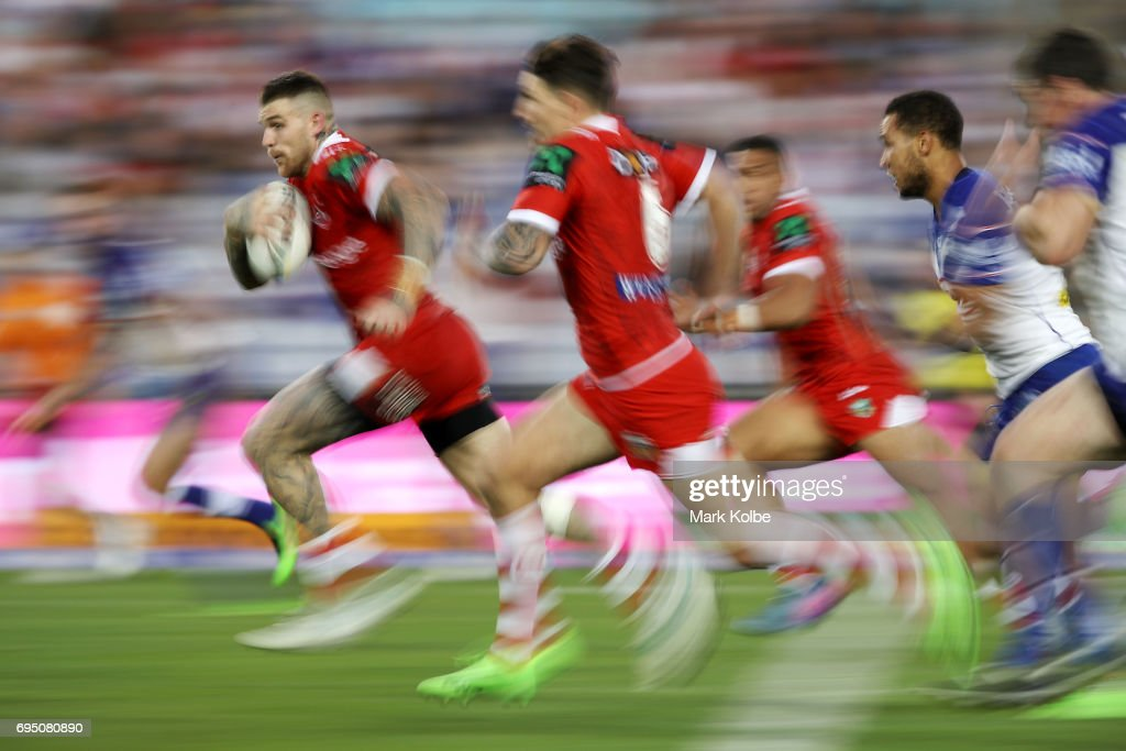 Josh Dugan of the Dragons makes a break during the round 14 NRL match between the Canterbury Bulldogs and the St George Illawarra Dragons at ANZ Stadium on June 12, 2017 in Sydney, Australia.