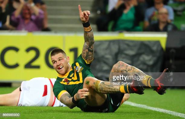 Josh Dugan of the Kangaroos celebrates after scoring a try during the 2017 Rugby League World Cup match between the Australian Kangaroos and England...