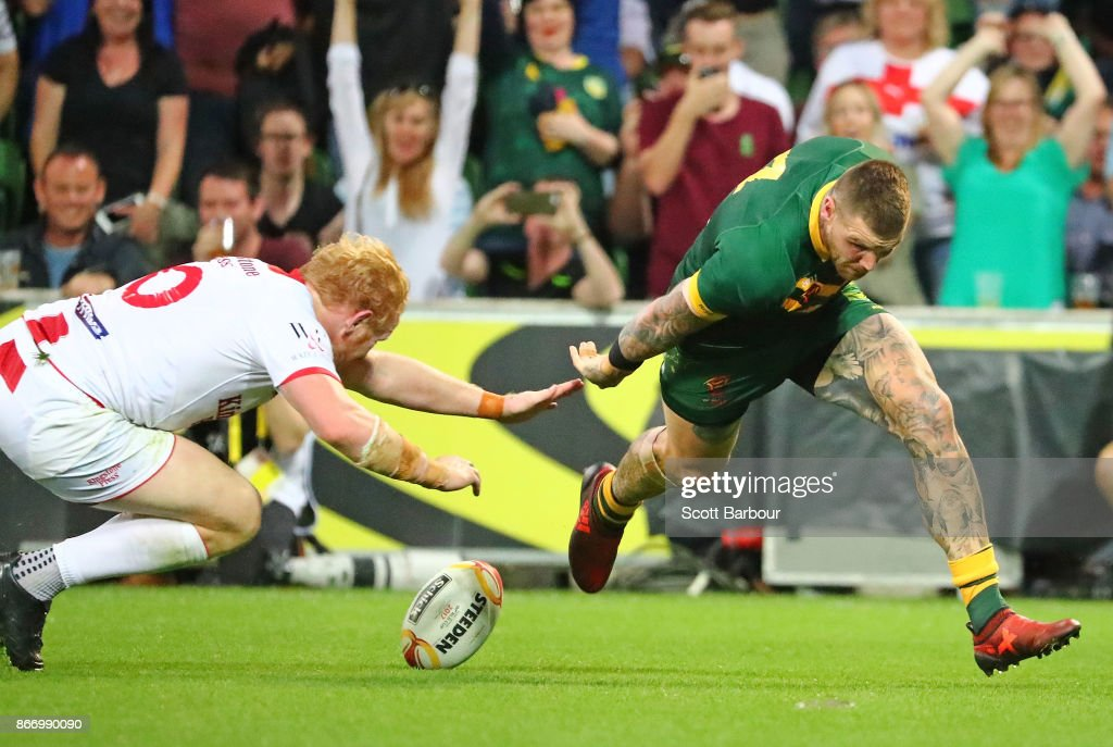 Josh Dugan of the Kangaroos runs in to score a try during the 2017 Rugby League World Cup match between the Australian Kangaroos and England at AAMI Park on October 27, 2017 in Melbourne, Australia.