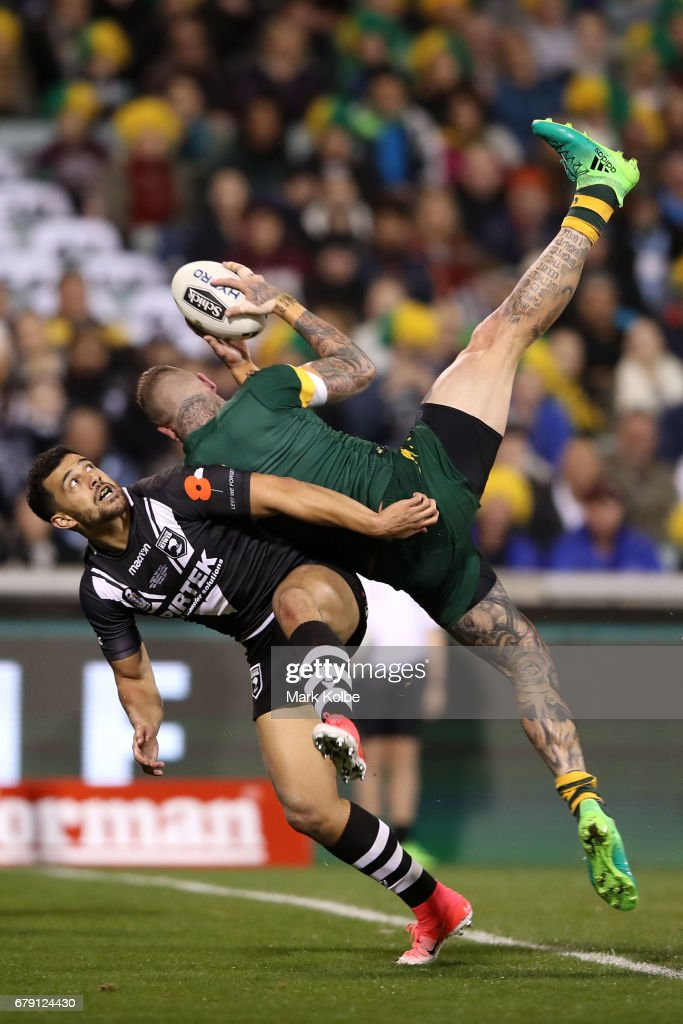 Josh Dugan of the Kangaroos scores a try over Jordan Kahu of the Kiwis during the ANZAC Test match between the Australian Kangaroos and the New Zealand Kiwis at GIO Stadium on May 5, 2017 in Canberra, Australia.