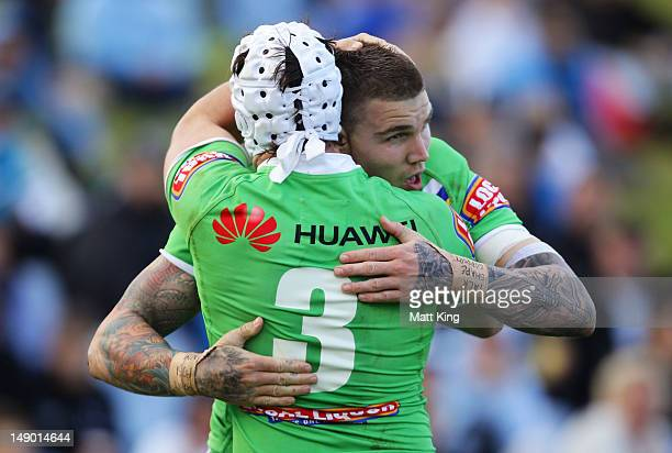 Josh Dugan of the Raiders celebrates with Jarrod Crocker afetr scoring a try during the round 20 NRL match between the Cronulla Sharks and the...