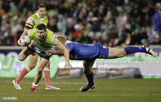 Josh Dugan of the Raiders is tackled by Ben Hannant of the Bulldogs during the round 16 NRL match between the Canberra Raiders and the Canterbury...