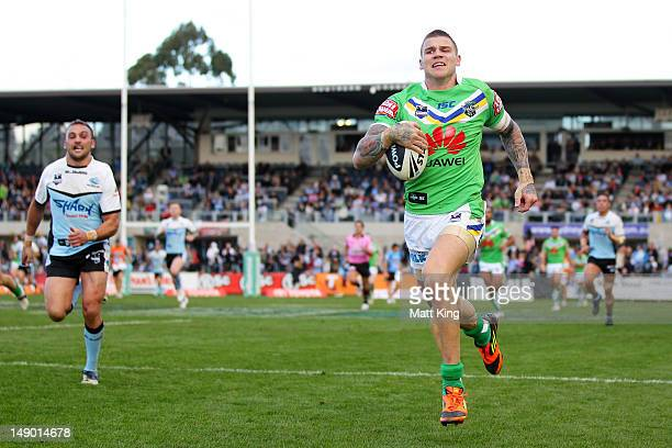 Josh Dugan of the Raiders runs towards the line to score a try after taking an intercept during the round 20 NRL match between the Cronulla Sharks...