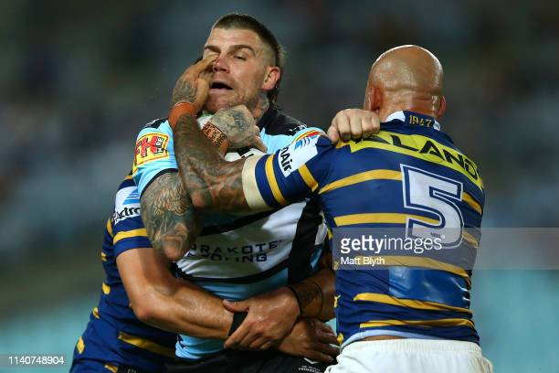 Josh Dugan of the Sharks is poked in the eye by Blake Ferguson of the Eels during the round four NRL match between the Parramatta Eels and the...