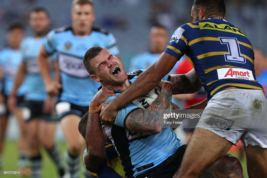 Josh Dugan of the Sharks is tackled during the round three NRL match between the Parramatta Eels and the Cronulla Sharks at ANZ Stadium on March 24, 2018 in Sydney, Australia.