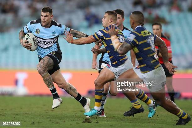 Josh Dugan of the Sharks is tackled during the round three NRL match between the Parramatta Eels and the Cronulla Sharks at ANZ Stadium on March 24...