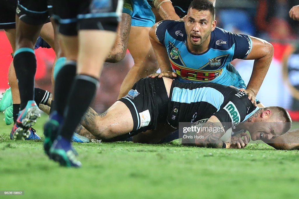 Josh Dugan of the Sharks leaves the field injured during the round eight NRL match between the Gold Coast Titans and Cronulla Sharks at Cbus Super Stadium on April 28, 2018 in Gold Coast, Australia.