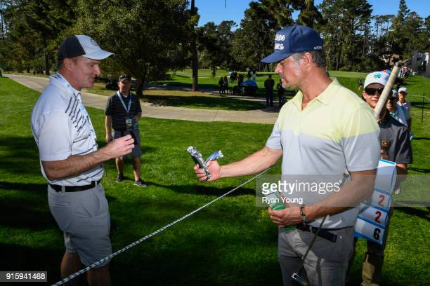 Josh Duhamel offers a girl scout cookie to a fan during the first round of the ATT Pebble Beach ProAm at Pebble Beach Golf Links on February 8 2018...
