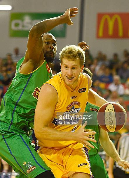 Josh Duinker of the Kings drives to the basket past Mickell Gladness of the Crocodiles during the round 15 NBL match between the Townsville...