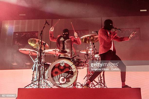 Josh Dun and Tyler Joseph of American musical duo Twenty One Pilots perform on stage on November 7 2016 in Milan Italy