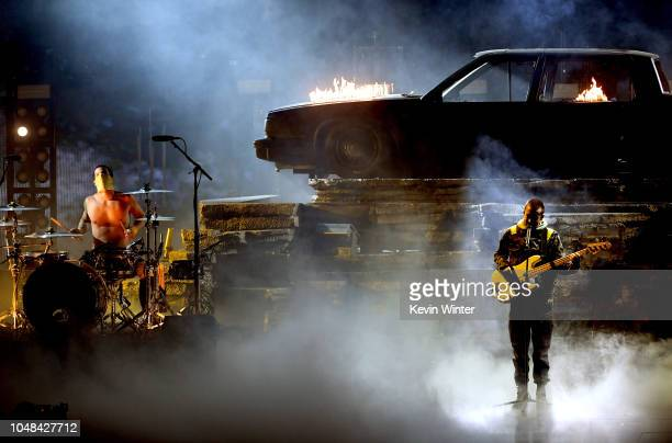 Josh Dun and Tyler Joseph of Twenty One Pilots perform onstage during the 2018 American Music Awards at Microsoft Theater on October 9 2018 in Los...