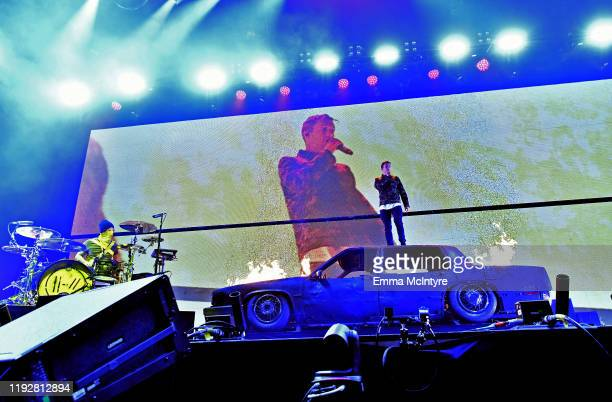 Josh Dun and Tyler Joseph of Twenty One Pilots perform onstage during KROQ Absolut Almost Acoustic Christmas 2019 at Honda Center on December 8 2019...