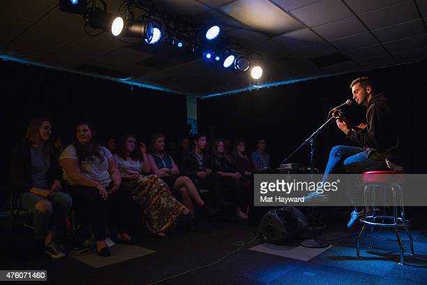 Josh Dun watches from the audience as and Tyler Joseph of Twenty One Pilots performs during an EndSession hosted by 1077 The End on June 5 2015 in...