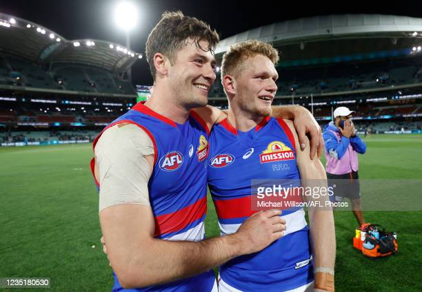 Josh Dunkley and Adam Treloar of the Bulldogs celebrate during the 2021 AFL Second Preliminary Final match between the Port Adelaide Power and the...