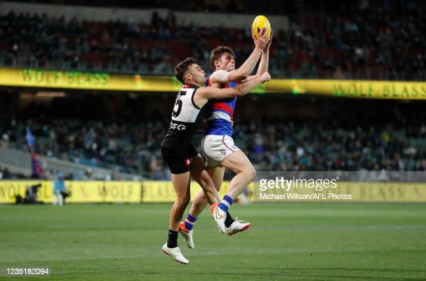 Josh Dunkley of the Bulldogs and Karl Amon of the Power in action during the 2021 AFL Second Preliminary Final match between the Port Adelaide Power...