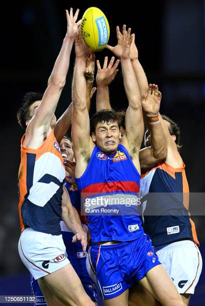 Josh Dunkley of the Bulldogs attempts to mark during the round 3 AFL match between the Western Bulldogs and the Greater Western Sydney Giants at...