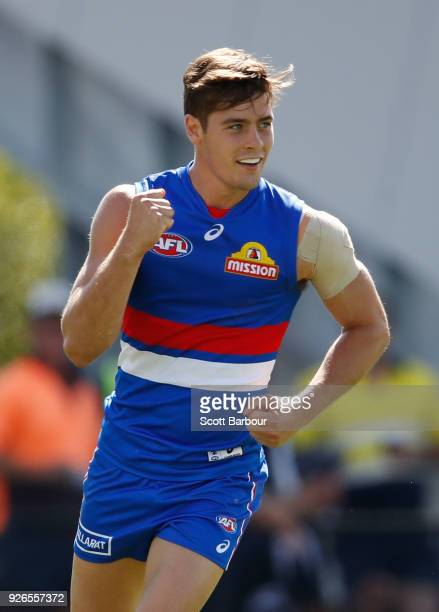 Josh Dunkley of the Bulldogs celebrates after kicking a goal during the AFL JLT Community Series match between the Western Bulldogs and the Hawthorn...