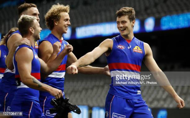 Josh Dunkley of the Bulldogs celebrates with teammates during the 2020 AFL Round 03 match between the Western Bulldogs and the GWS Giants at Marvel...