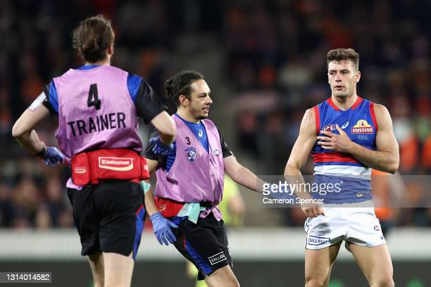 Josh Dunkley of the Bulldogs injures his shoulder during the round six AFL match between the Greater Western Sydney Giants and the Western Bulldogs...